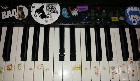close up of festive synthesizer keyboard covered with kitty stickers, used by BipTunia to make the first 4 BipTunia albums.